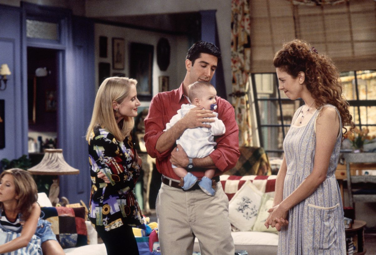 Ross holds his son with his ex-wife Carol, and Susan