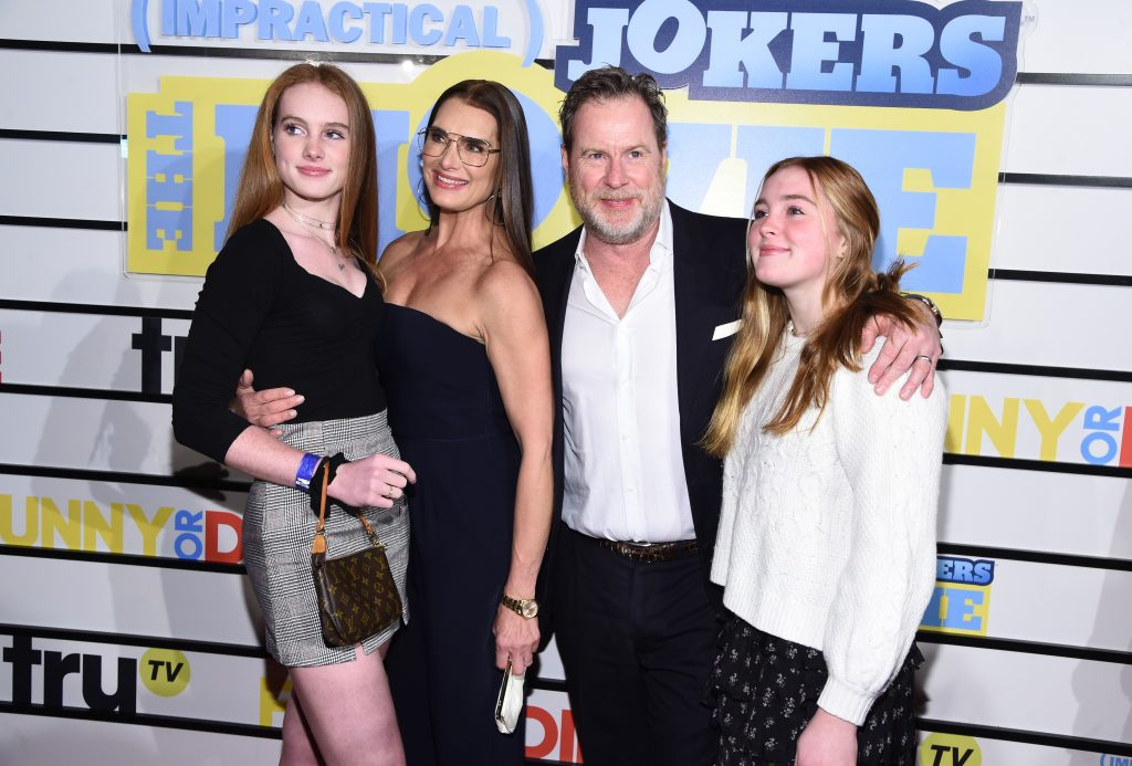 Rowan Francis Henchy, Brooke Shields, Chris Henchy, and Grier  Henchy pose for a family photo at premiere of 'Impractical Jokers: The Movie'