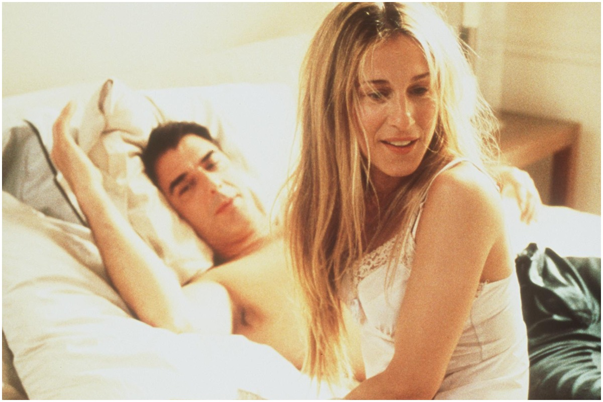 Sarah Jessica Parker and Chris Noth relaxing in bed as Carrie Bradshaw and Mr. Big on 'Sex and the City'