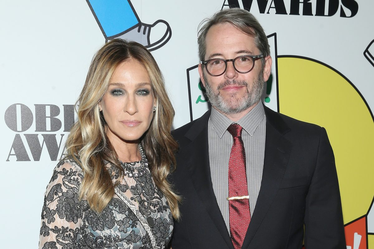 Sarah Jessica Parker and Matthew Broderick posing together while attending a red carpet event.