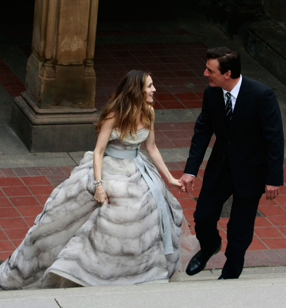 Sarah Jessica Parker and Chris Noth walk in Central Park holding hands during a photoshoot