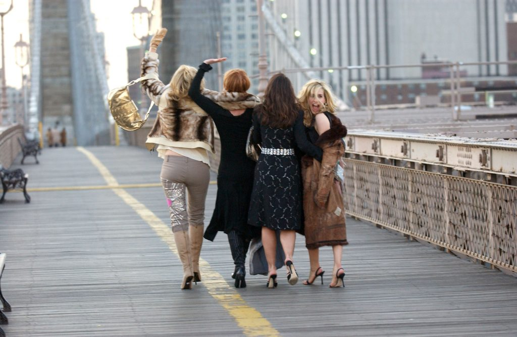 Kim Cattrall, Cynthia Nixon, Kristin Davis and Sarah Jessica Parker are photographed from behind walking across the Brooklyn Bridge during a promotional shoot for 'Sex and the City: The Movie'