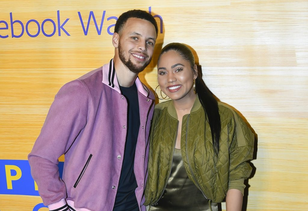 Steph Curry and Ayesha Curry smile and pose together on the carpet at the Stephen vs The Game Facebook Watch Preview