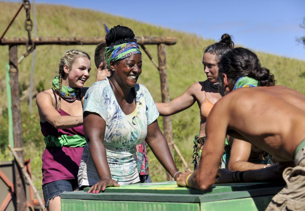 Cirie Fields laughing with a contestant on the beach in 'Survivor: Game Changers'