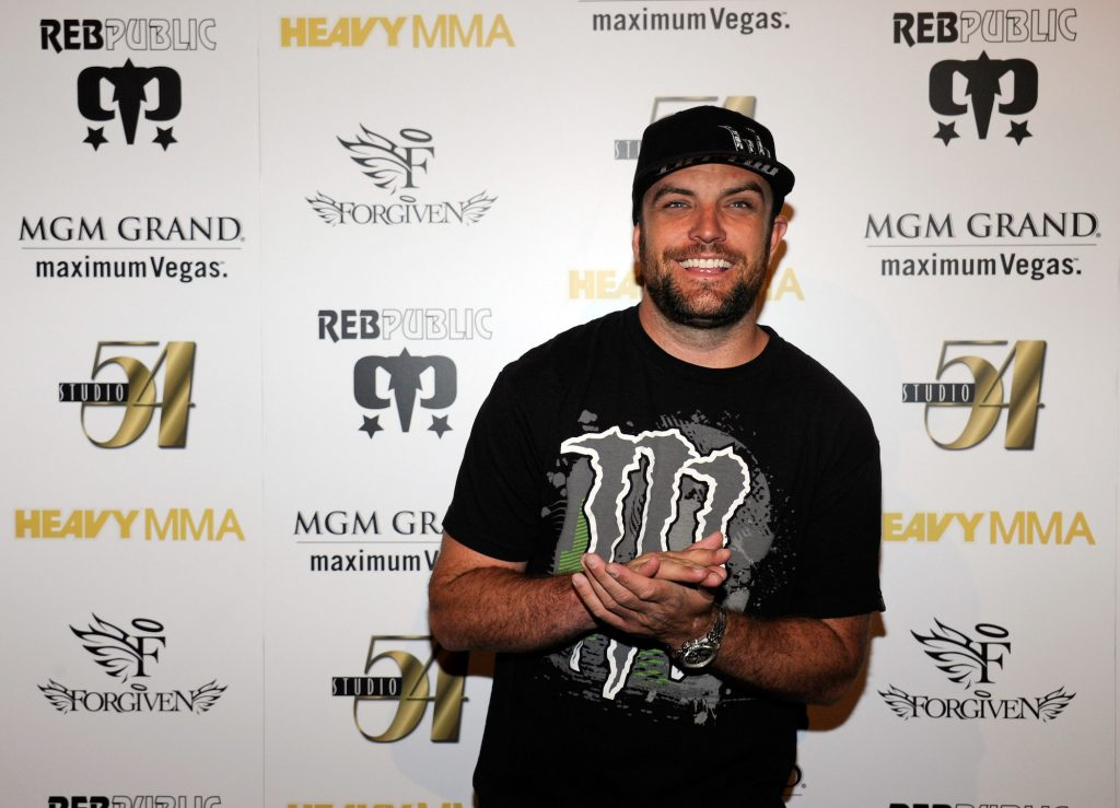 T.J. Lavin, the host of MTV's 'The Challenge,' smiling at an event