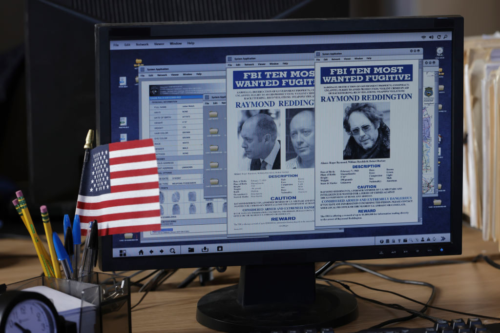 A computer screen shows the FBI's Most wanted man, Raymond Reddington, played by James Spader.