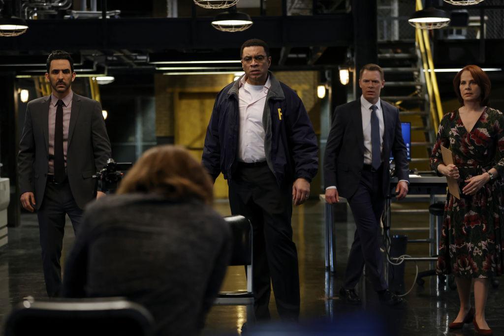 Amir Arison as Aram Mojtabai, Seth Numrich as Rakitin, Harry Lennix as Harold Cooper, Diego Klattenhoff as Donald Ressler, Deirdre Lovejoy as Cynthia Panabaker all stand together in the FBI office.
