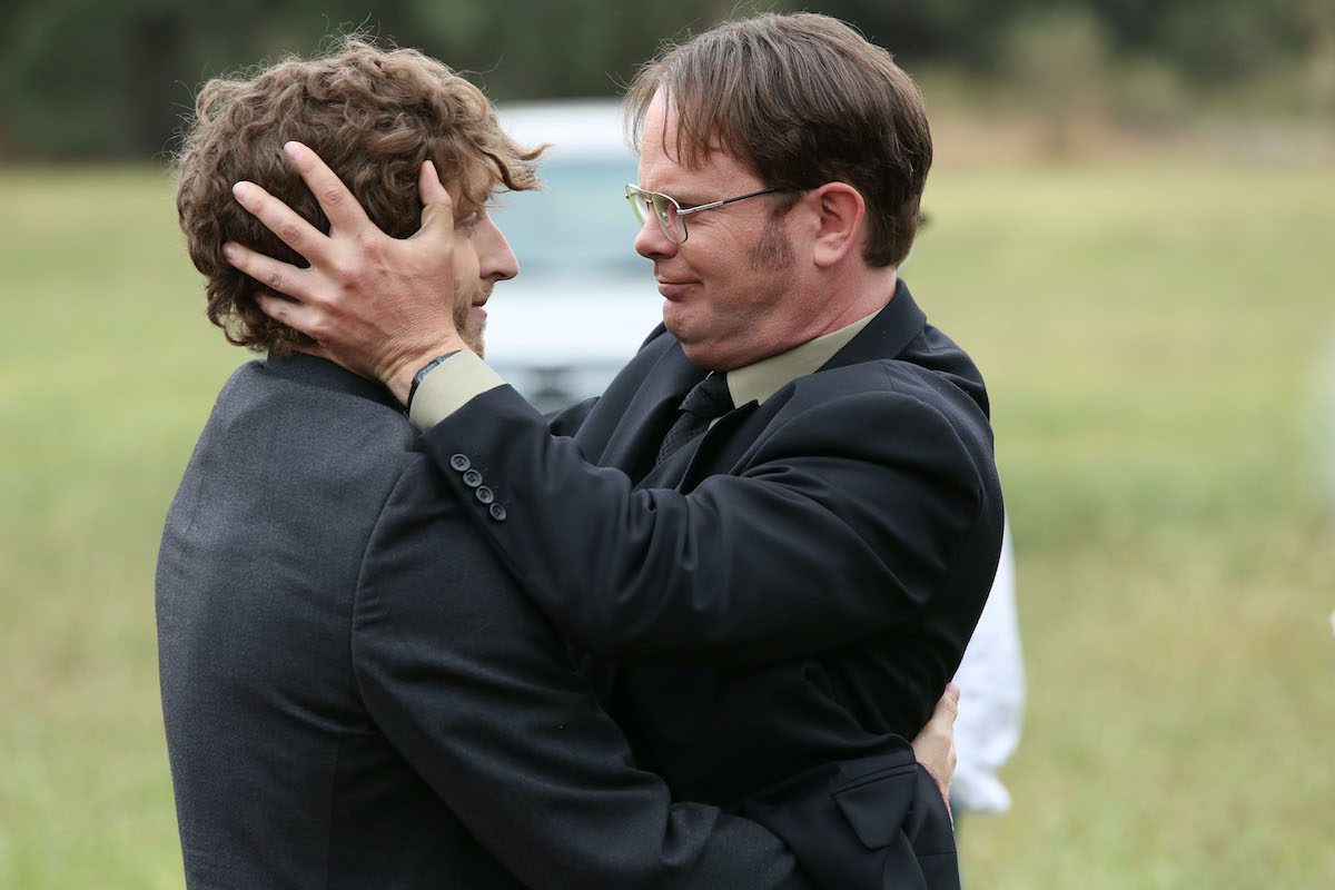 Thomas Middleditch as Jeb Schrute and Rainn Wilson as Dwight Schrute embracing in a scene from 'The Farm'