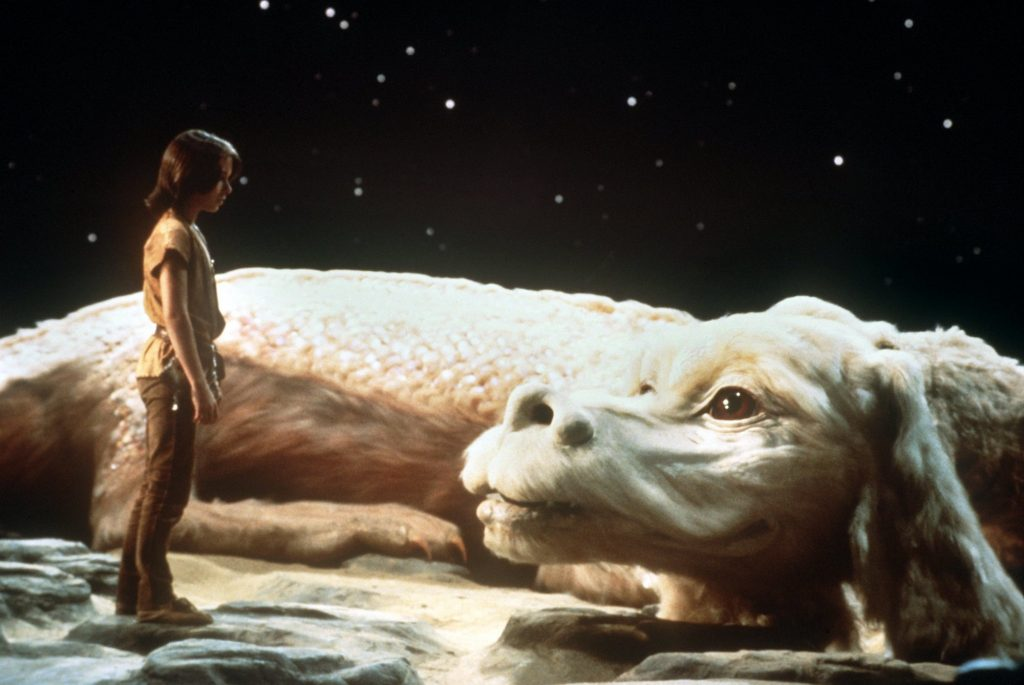 Noah Hathaway as Atreju with the white dragon from 'The NeverEnding Story'