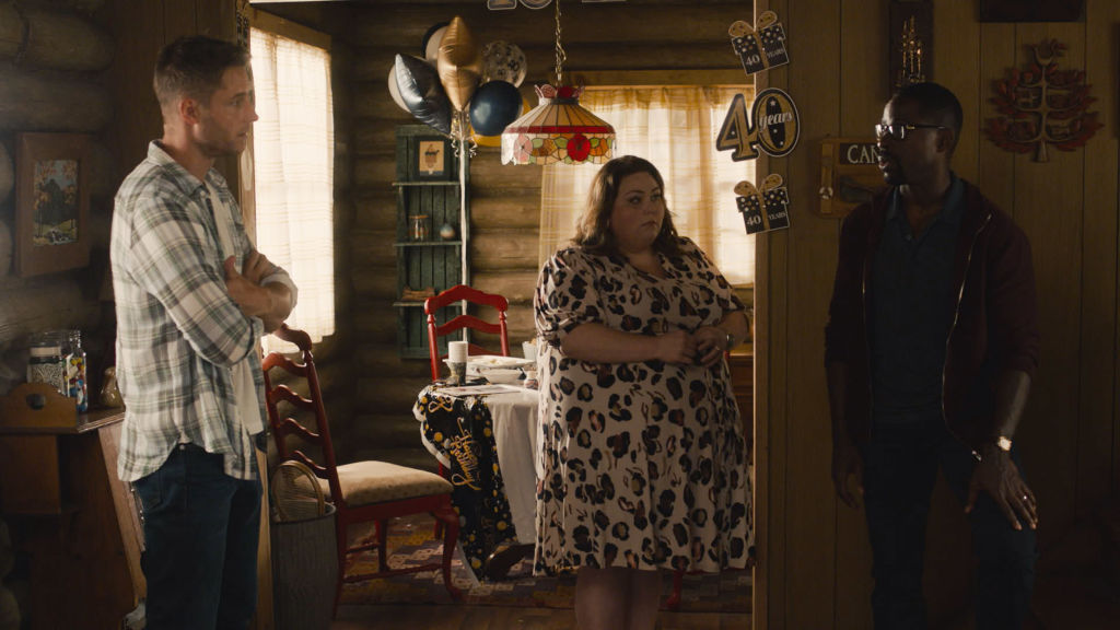 Justin Hartley as Kevin, Chrissy Metz as Kate, Sterling K. Brown as Randall stand looking at one another in the family cabon.