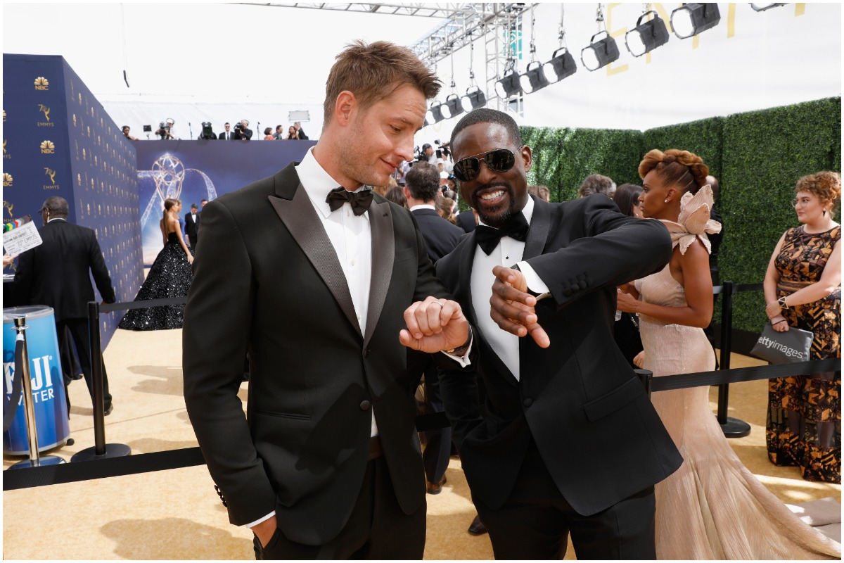'This Is Us' co-stars Sterling K. Brown and Justin Hartley wearing black and white suits and looking at their watches.