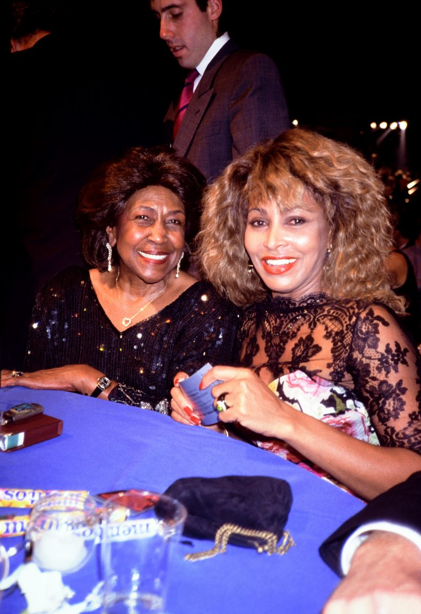 Tina Turner and her mother Zelma Bullock sit at a table