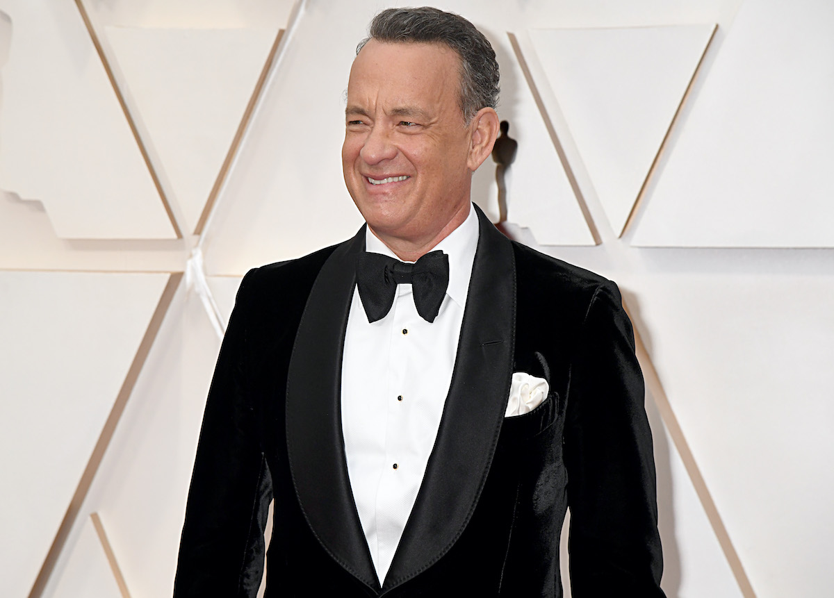 Tom Hanks smiles in a dark suit at the 92nd Annual Academy Awards