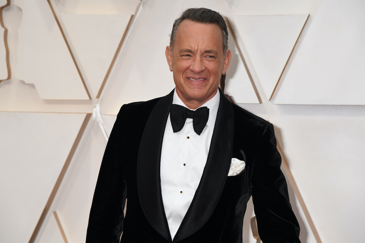 Tom Hanks smiles in a suit at the 92nd Annual Academy Awards