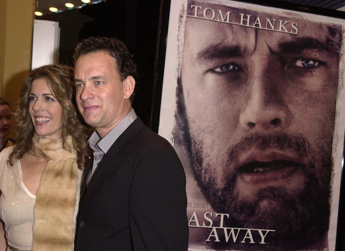 Tom Hanks and Rita Wilson pose in front of a 'Cast Away' poster