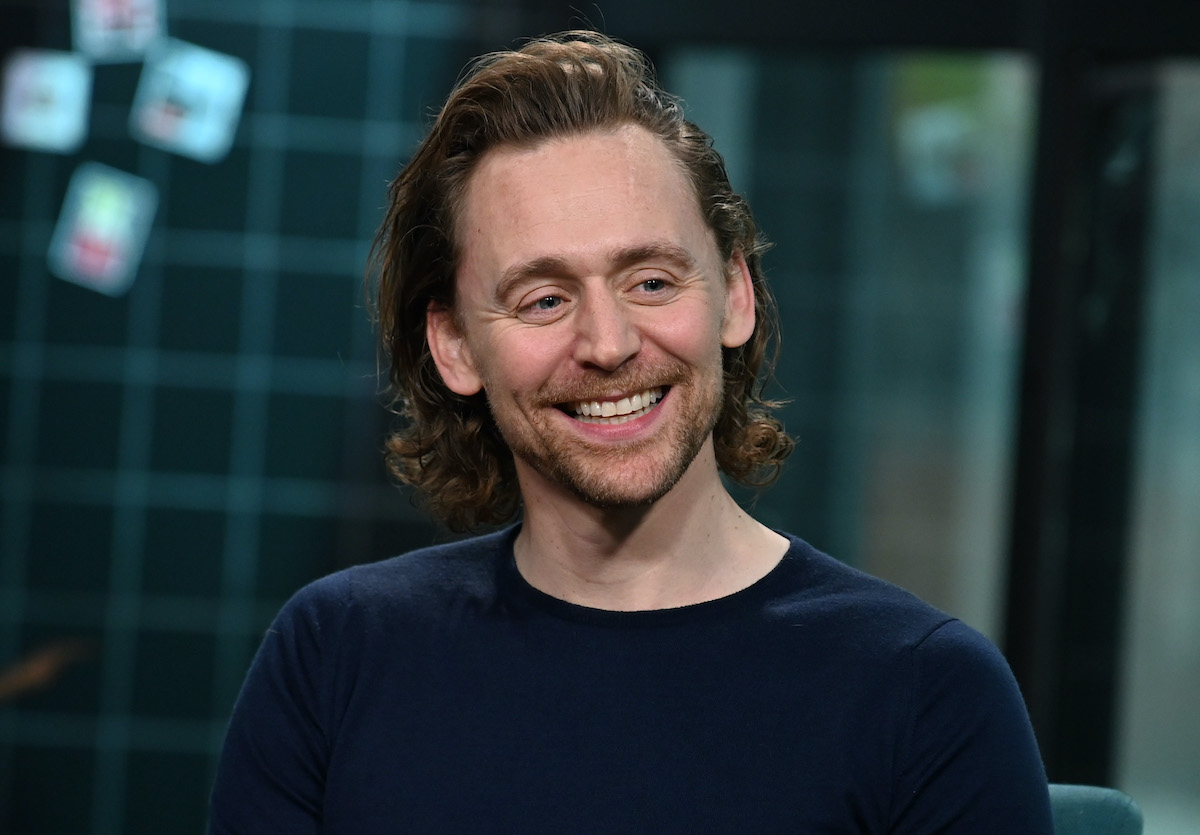 Tom Hiddleston smiles during a visit to Build Series