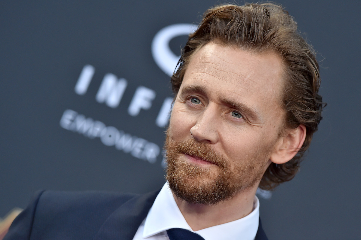 Tom Hiddleston wears a suit and poses at the 'Avengers: Infinity War' premiere