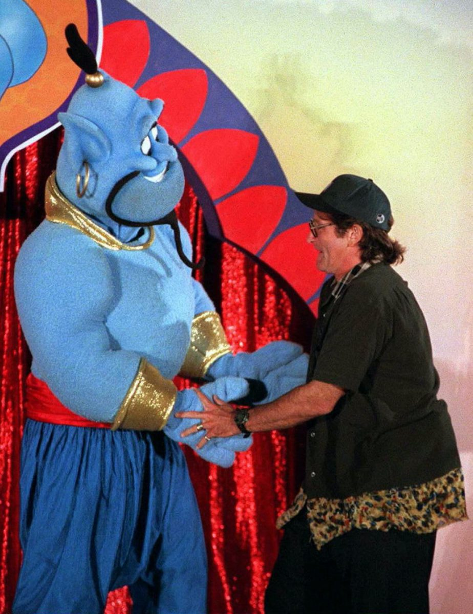 "Actor-comedian Robin Williams dances 10 July in Los Angeles with the Disney character ""Genie"" during a celebration for the scheduled 13 August world release of the film 'Aladdin'"