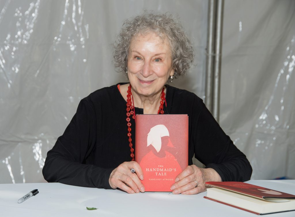 Author Margaret Atwood with a copy of The Handmaid's Tale
