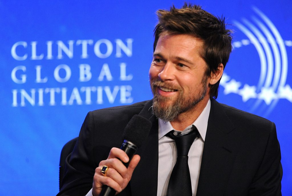 Brad Pitt with a microphone