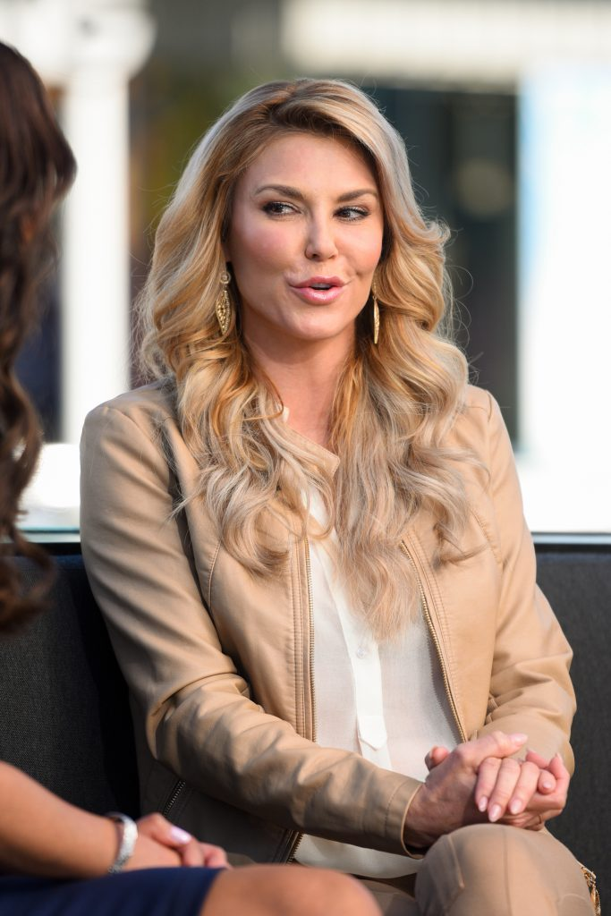 Brandi Glanville doing an interview for 'Extra' in 2015