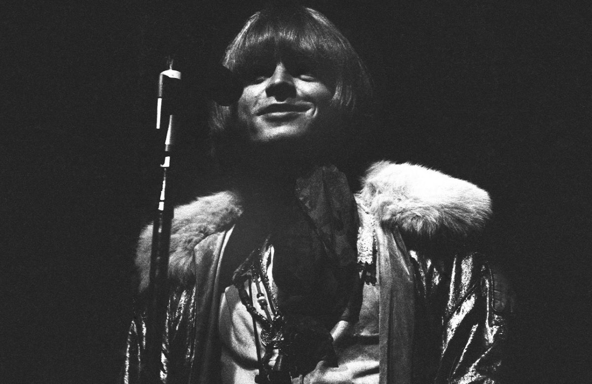 Brian Jones smiling at the microphone at Monterey Pop