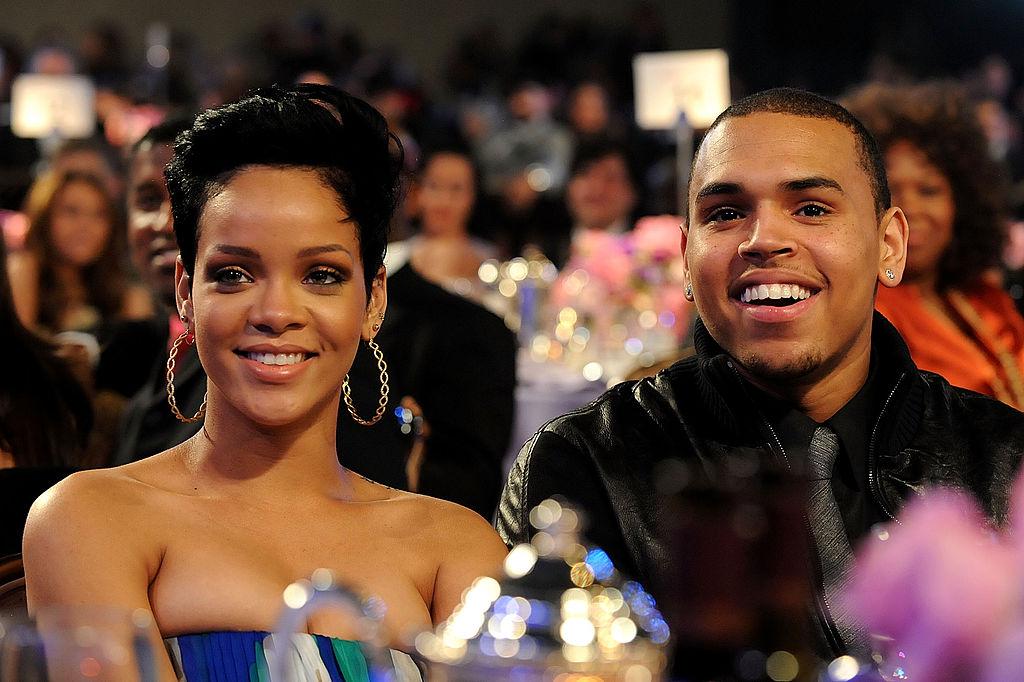 Rihanna and Chris Brown at a table