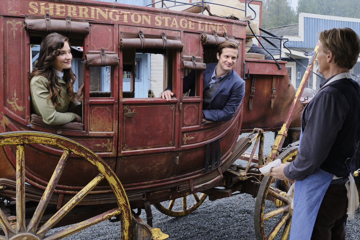 Clara and Jesse on stagecoach in When Calls the Heart