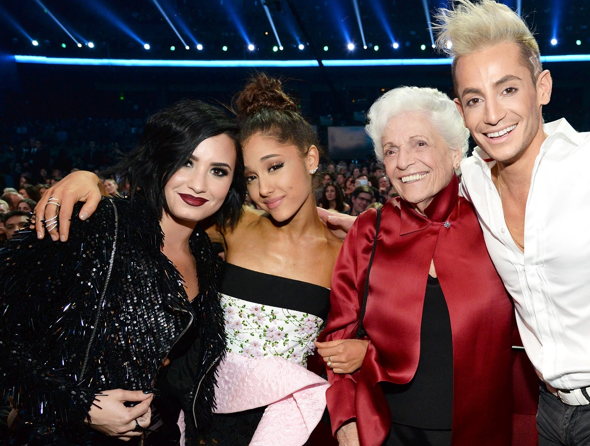 Demi Lovato (L), Ariana Grande (second from L), and Frankie Grande (R) at the 2015 American Music Awards on November 22, 2015, in Los Angeles, California.