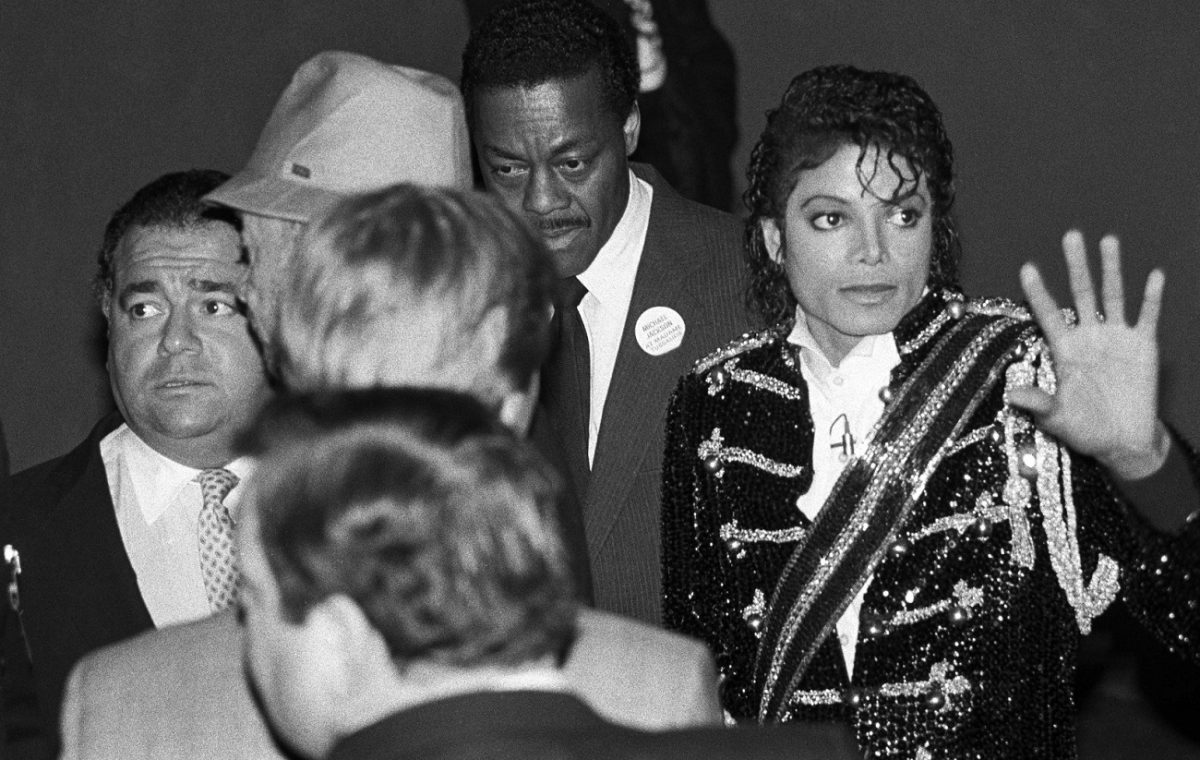 Frank DiLeo looks off-camera as Michael Jackson waves to fans