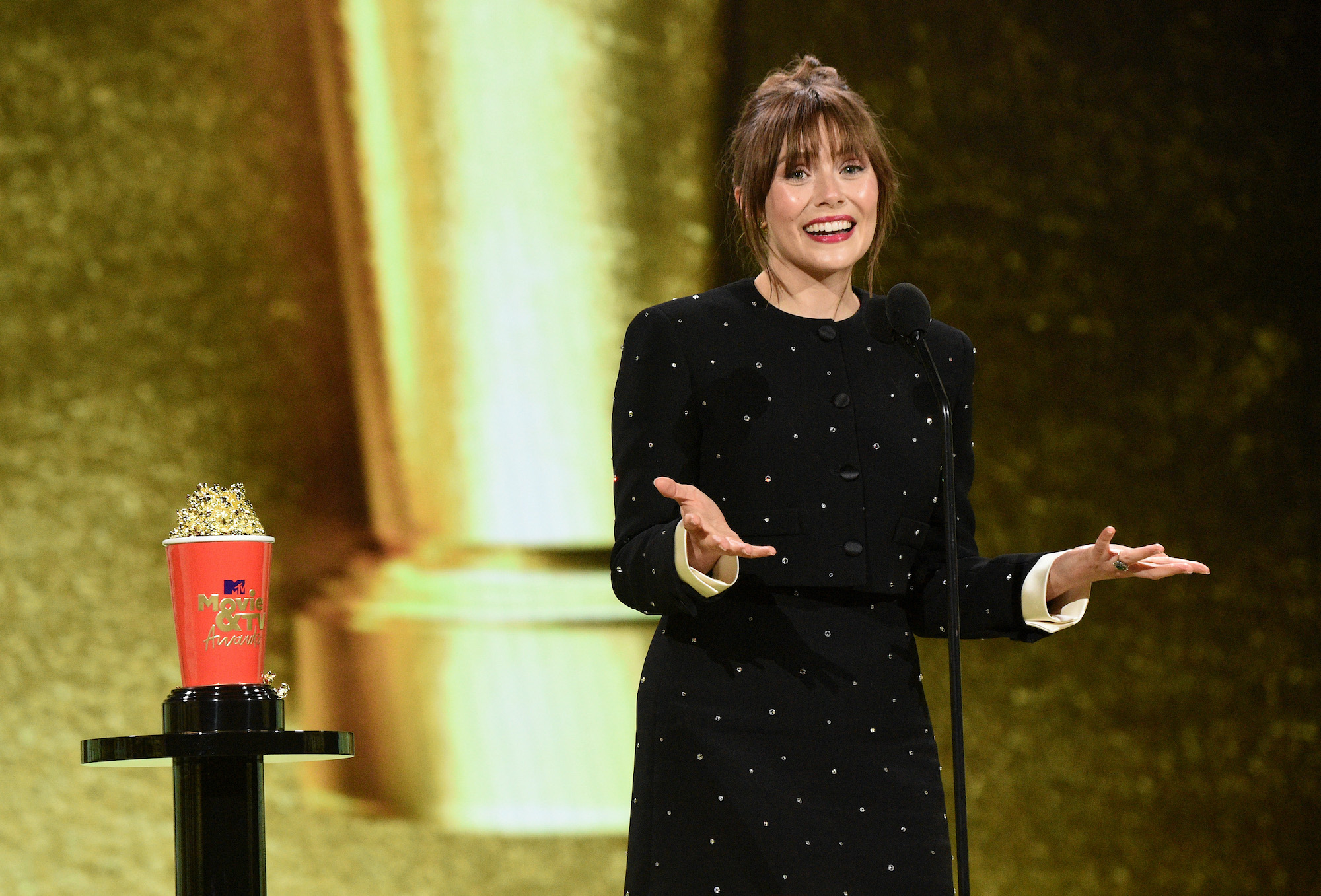 Elizabeth Olsen accepts the Best Performance in a Show award for 'WandaVision' onstage at the 2021 MTV Movie & TV Awards on May 16, 2021