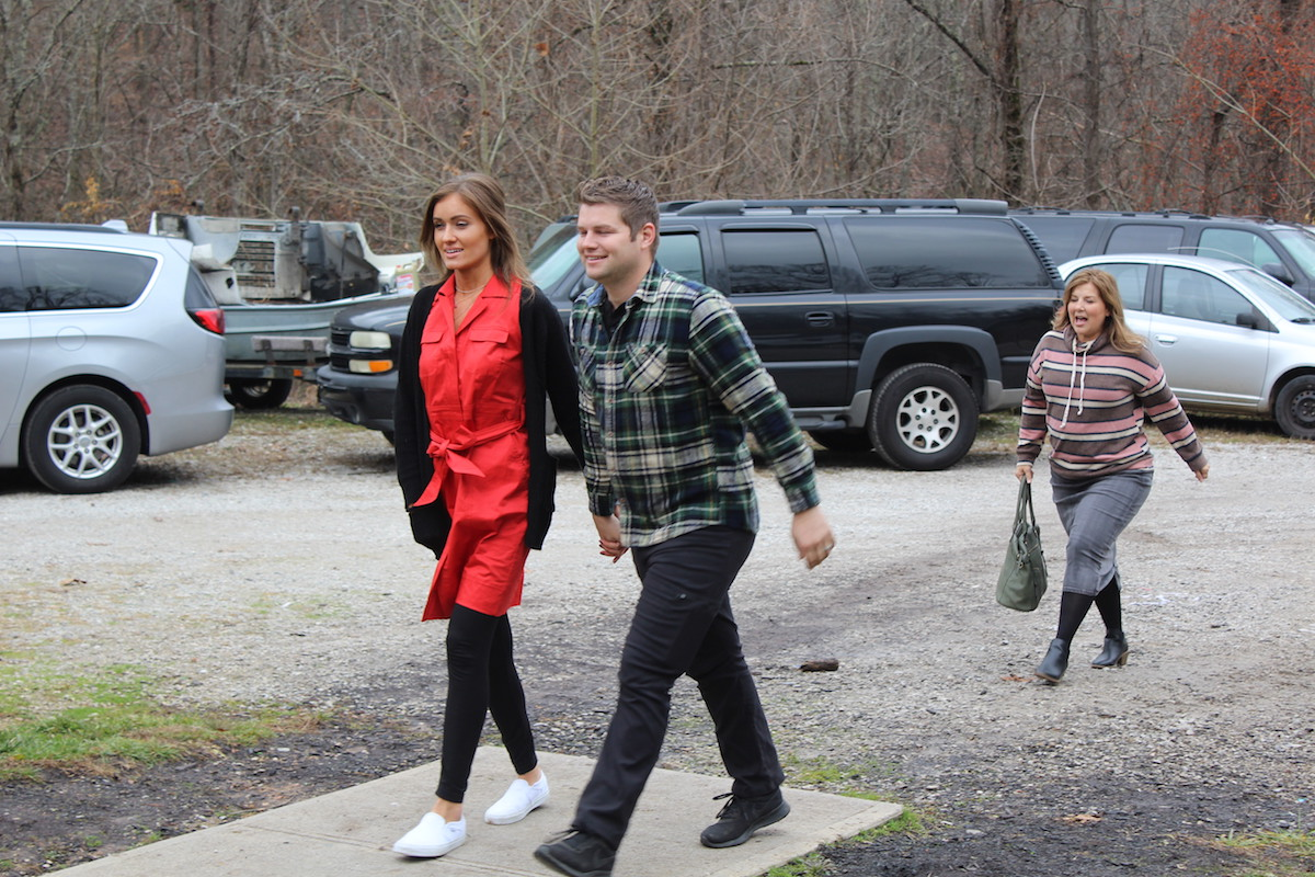 Esther Keyes and Nathan Bates holding hands and walking in episode of Bringing Up Bates