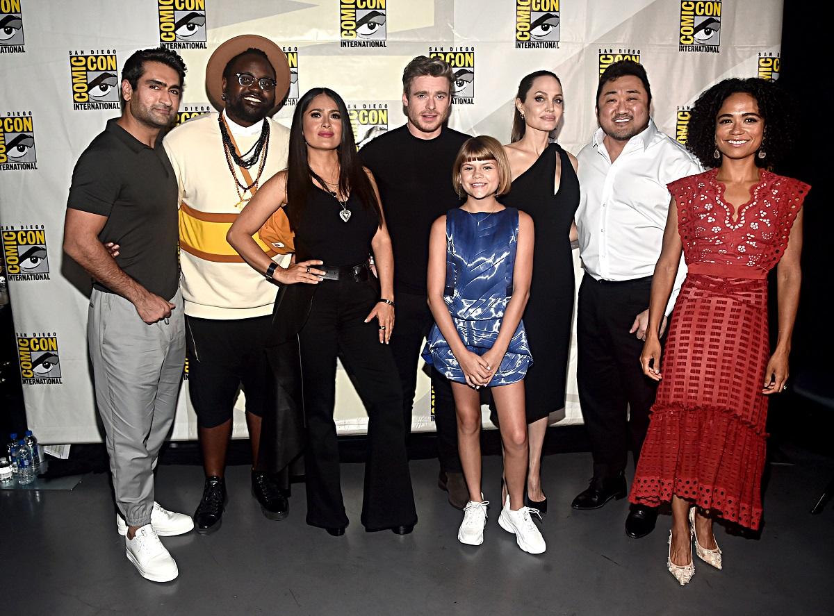 (L-R) Kumail Nanjiani, Brian Tyree Henry, Salma Hayek, Richard Madden, Lia McHugh, Angelina Jolie, Don Lee, and Lauren Ridloff of Marvel Studios' 'Eternals'