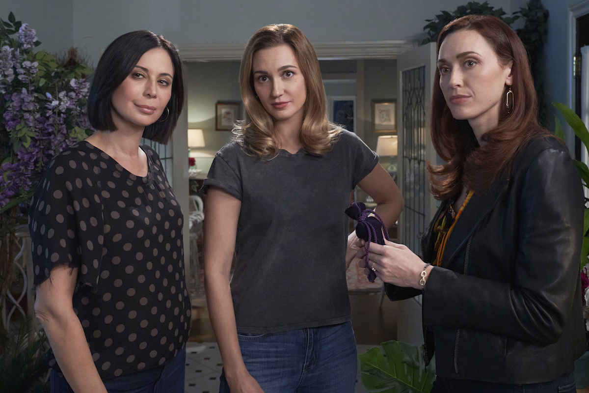 Cassie, Abigail, and Joy looking at he camera in Good Witch season 7 premiere