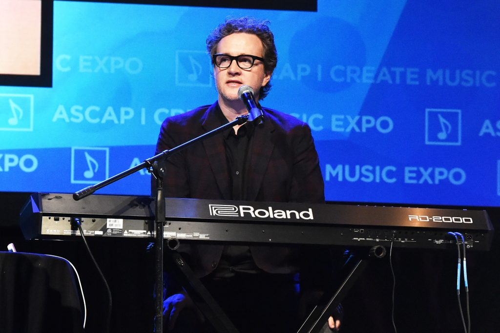 Greg Wells wit a piano