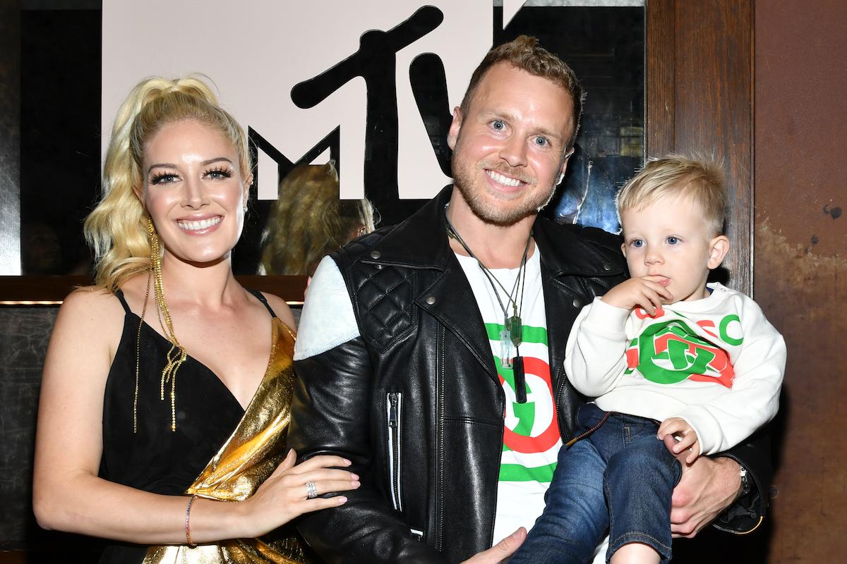 Heidi Montag, wearing black sleeveless top, with Spencer Pratt, who is holding their son Gunner