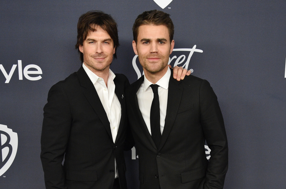 Ian Somerhalder and Paul Wesley attend the 21st Annual Warner Bros. and InStyle Golden Globes afterparty on January 5, 2020. They pose in black suits in front of a grey backdrop. Wesley and Somerhalder are lifelong friends after having starred in 'The Vampire Diaires' together for eight seasons.
