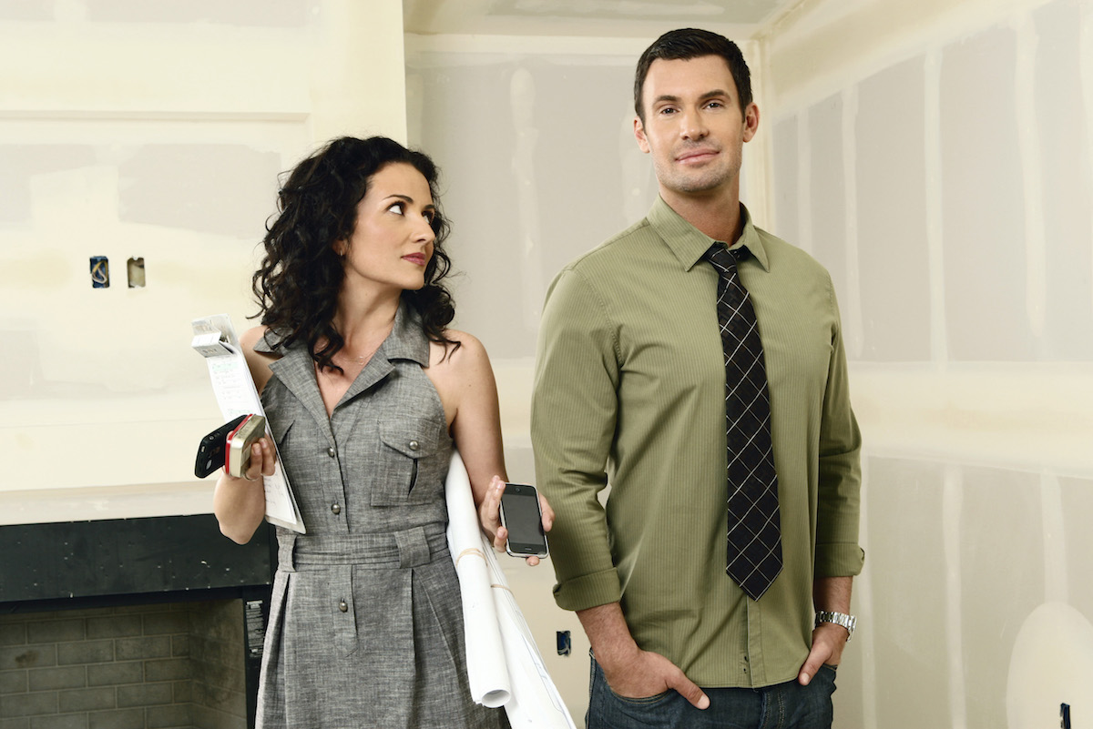 Jenni Pulos in a sleeveless gray dress and Jeff Lewis in an untucked button down shirt in Flipping Out