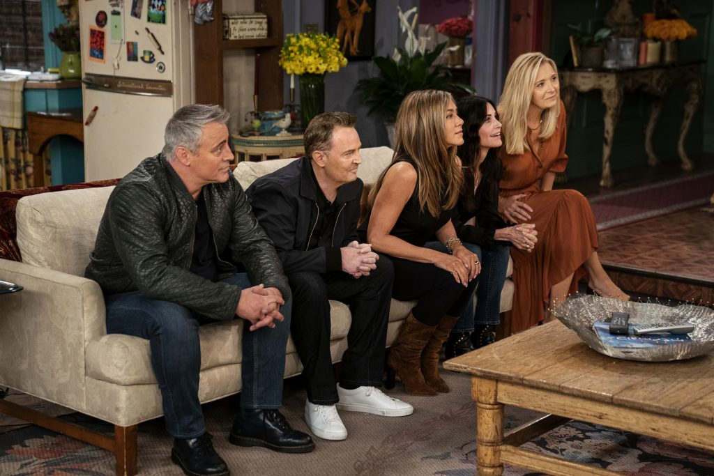 The cast of 'Friends' sit on a couch while playing trivia during the reunion special.
