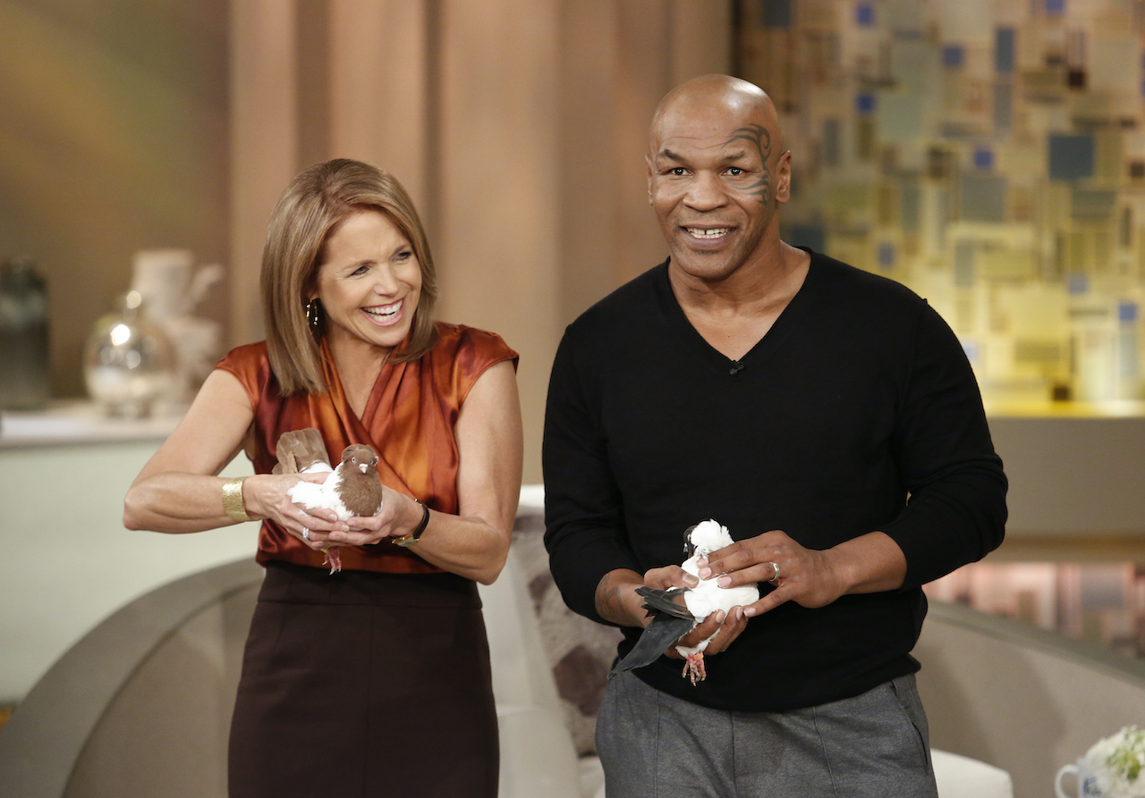 Mike Tyson plays with his pigeons alongside Katie Couric