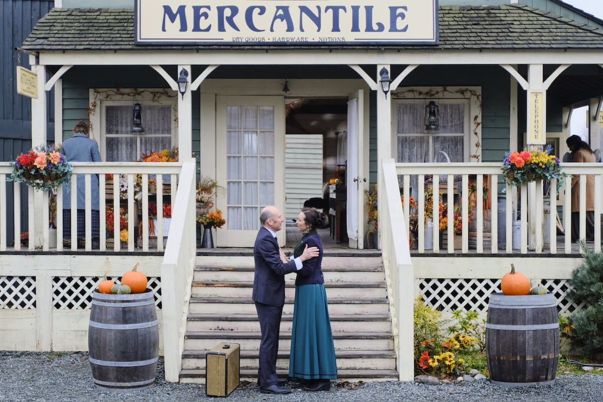 Ned and Florence outside the mercantile in When Calls the Heart
