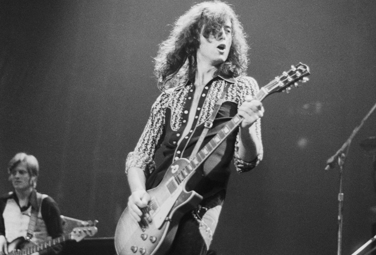 Jimmy Page plays guitar on stage with Led Zeppelin