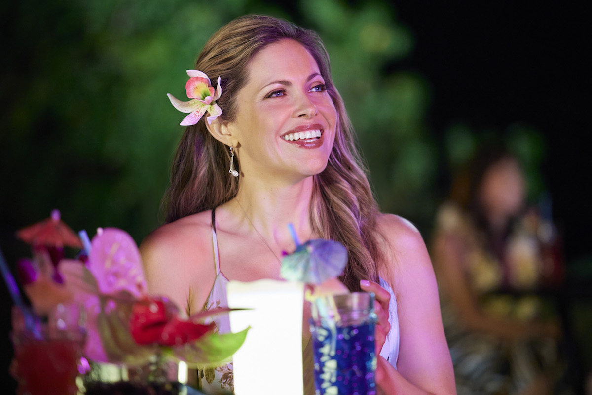 Smiling Pascale Hutton with a flower in her hair in You Had Me at Aloha