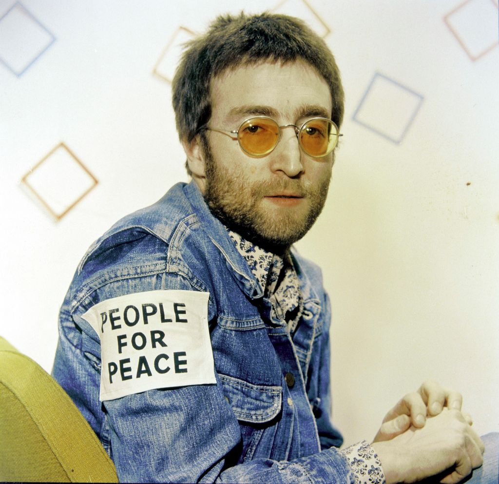"""The Beatles' John Lennon with a """"People for Peace"""" patch"""