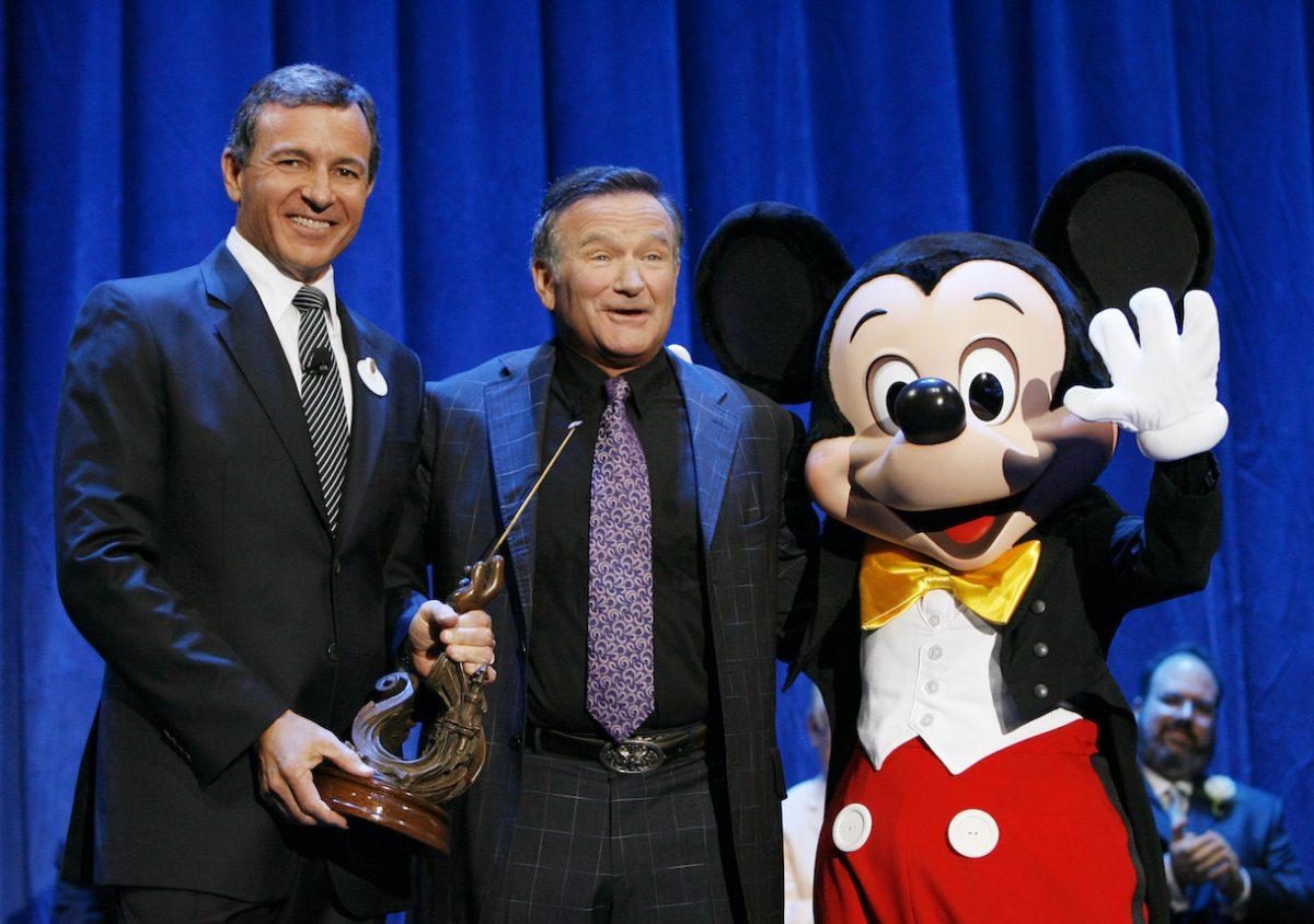 "In this handout image provided by Disney, actor Robin Williams (C) is recognized by Bob Iger, CEO of Walt Disney Co.,and Mickey Mouse for Williams' work in ""Aladdin,"""