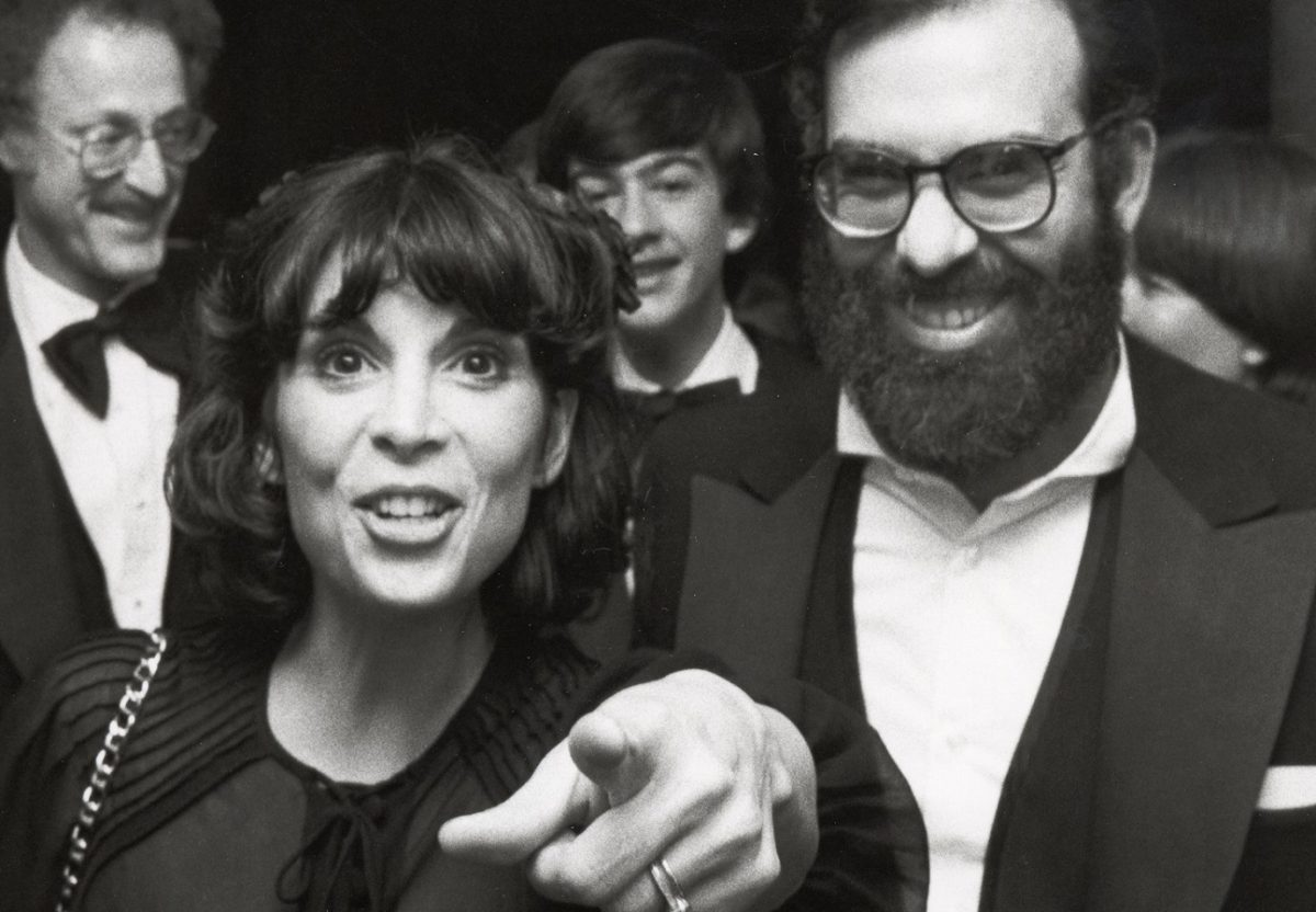 Talia Shire points at the camera and smiles and Francis Ford Coppola laughs.