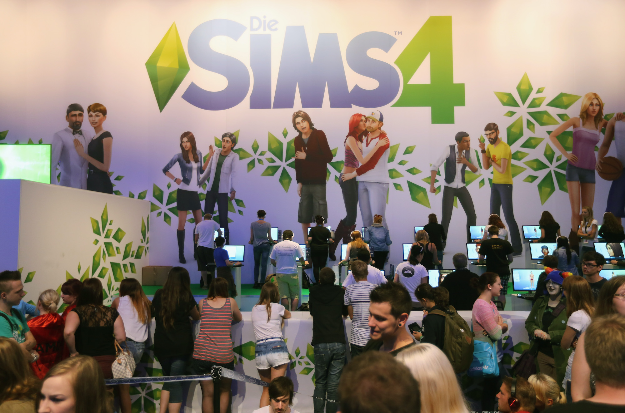 Gaming enthusiasts try out the 'The Sims 4' game on the new XBOX at the Gamescom 2013 gaming trade air on August 22, 2013