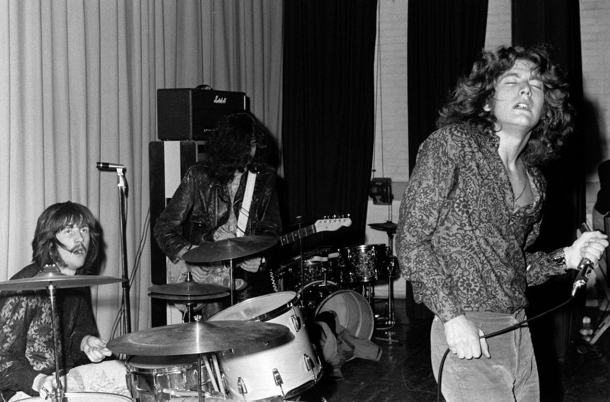 Led Zeppelin performs on stage at a club in 1969.