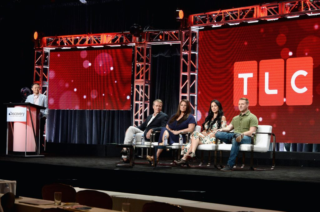 TLC executives gathered on stage at a conference