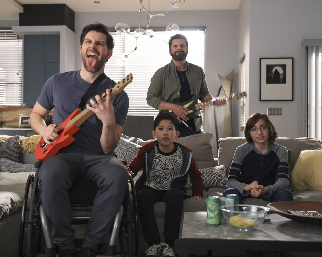 A Million Little Things Season 3 Eddie Saville and Gary Mendez play video games with Theo and Liam